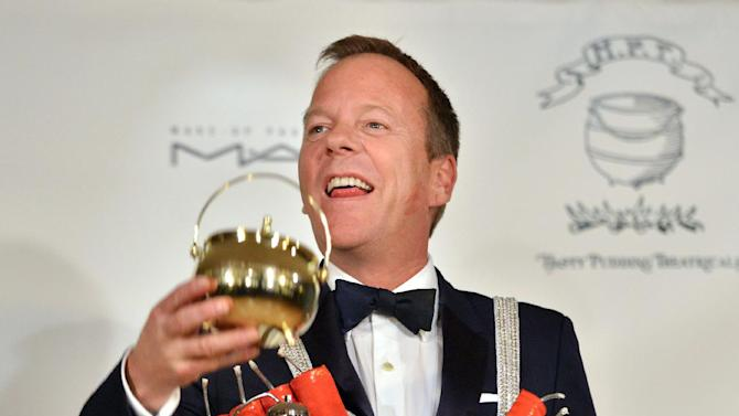 Actor Kiefer Sutherland reacts as he is honored as the Hasty Pudding Man of the Year at Harvard University in Cambridge, Mass., Friday, Feb. 8, 2013. Sutherland was roasted and received the pudding pot from the nation's oldest undergraduate drama troupe. (AP Photo/Josh Reynolds)