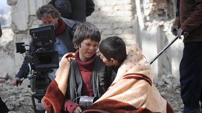 "An undated production still photograph from the Oscar-nominated film, ""Buzkashi Boys,"" which was filmed in Kabul, Afghanistan, shows actors Jawanmard Paiz, center, Fawad Mohammadi, right, and director Sam French at work on the set of the film. The actors were plucked from the dingy streets of the Afghan capital to be the main stars of ""Buzkashi Boys,"" a coming-of-age movie filmed entirely in a war zone and nominated in the Best Live Action Short Film category. (AP Photo/David Gill, Afghan Film Project)"