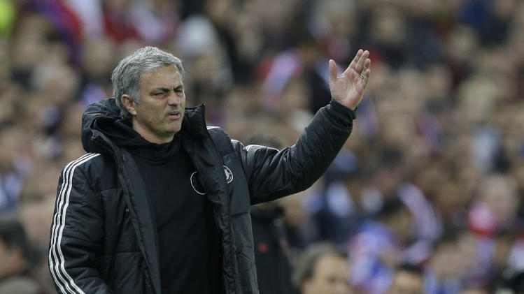Chelsea's manager Jose Mourinho gestures as he watches his team from the technical area during the Champions League semifinal first leg soccer match between Atletico Madrid and Chelsea at the Vicente Calderon stadium in Madrid, Spain, Tuesday, April 22, 2014 .(AP Photo/Paul White)