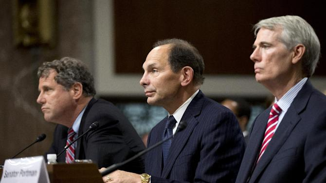 Veterans Affairs Secretary nominee Robert McDonald of Ohio flanked by Sens. Sherrod Brown, D-Ohio, left, and Rob Portman, R-Ohio, right, listen during a Senate Veterans' Affairs Committee hearings to examine his nomination to be Secretary of Veterans Affairs on Capitol Hill in Washington, Tuesday, July 22, 2014. (AP Photo)