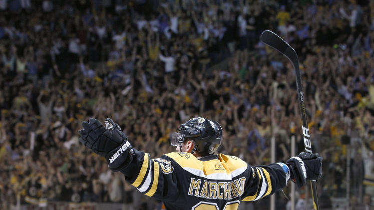 Boston Bruins left wing Brad Marchand (63) reacts after scoring a goal against the Vancouver Canucks during Game 4 of the NHL hockey Stanley Cup finals, Wednesday, June 8, 2011, in Boston. (AP Photo/Elise Amendola)