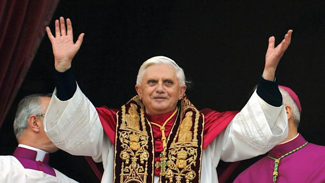 """FILE - This April 19, 2005 file photo shows Pope Benedict XVI greeting the crowd from the central balcony of St. Peter's Basilica moments after being elected, at the Vatican. """"Naturally the pope couldn't change completely at that moment, so he went out with those black sleeves _ we could see his sweater!"""" Vatican's master of liturgical celebrations Piero Marini recalled. """"But even that was a human gesture of how he was dressed as a cardinal."""" Next month's conclave to elect the 266th leader of the world's 1.2 billion Catholics will have all the trappings of papal elections past, with the added twist that the this time around the current pope is still very much alive. (AP Photo/Domenico Stinellis/FILE)"""
