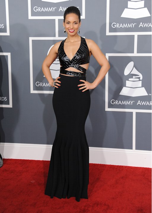 Alicia Keys arrives at the 55th annual Grammy Awards on Sunday, Feb. 10, 2013, in Los Angeles.  (Photo by Jordan Strauss/Invision/AP)