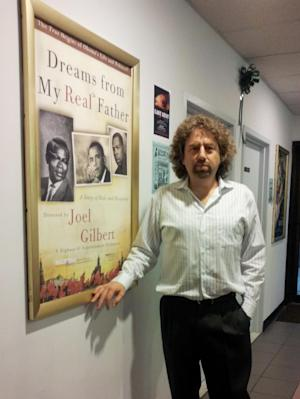 "This handout photo provided by Joel Gilbert, taken Sept. 19, 2012, shows Mr. Gilbert at the film screening for his movie ""Dreams from My Real Father"" in Bellmore, NY. With a week until Election Day, the nasty campaign tactics are coming out. The film was mailed for free to some seven million homes. The film claims that Obama's real father was  Frank Marshall Davis, a communist agitator, author and poet who lived in Hawaii, not the former Kenyan goat herder who share's the president's name. Both men are deceased. (AP Photo/Joel Gilbert, HO)"