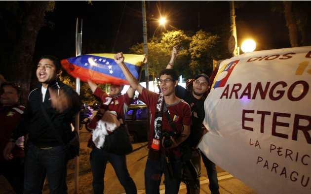 Venezuela's fans cheer for their team outside Monumental stadium before the team training session in Buenos Aires