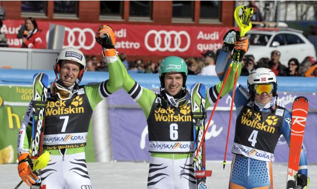Second-placed Dopfer, winner Neureuther and third-placed Kristoffersen celebrate after the Alpine Skiing World Cup men's slalom ski race in Kranjska Gora