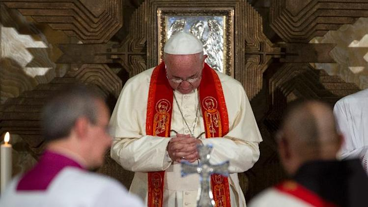 Pope Francis prays during a meeting with prelates, nuns and seminarists at the Church of All Nations in the Garden of Gethsemane, in east Jerusalem, on May 26, 2014
