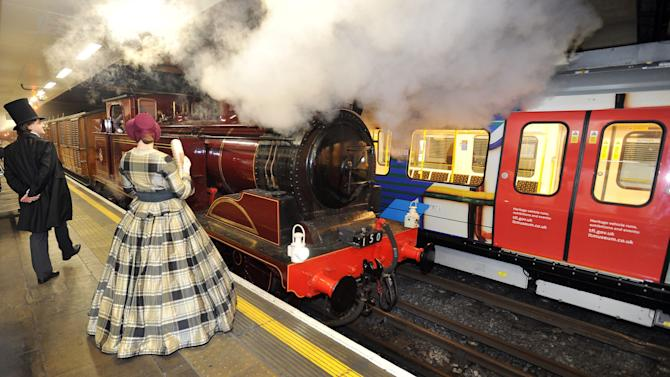 Metropolitan 1, a restored steam train built in 1898, arrives at Moorgate underground station in the City of London, to celebrate the 150th anniversary of the opening of the London underground railway system, where it stopped after a journey from Olympia in west London, Sunday Jan. 13, 2013. (AP Photo/PA, John Stillwell) UNITED KINGDOM OUT