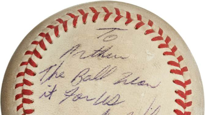 """ADDS THE AMOUNT BALL SOLD FOR $418,250 - This undated image, provided by Heritage Auctions, shows the """"Buckner Ball,"""" the baseball that dribbled between the legs of Boston Red Sox first baseman Bill Buckner during the 10th inning of Game 6 of the 1986 World Series. The error gave the New York Mets the win and the team went on to beat the Red Sox the next night to win the World Series. The writing, by Mookie Wilson addressed to Mets traveling secretary Arthur Richman says: To Arthur, the ball won it for us, Mookie Wilson, Oct. 25, 1986. Heritage Auctions said the ball is expected to bring in more than $100,000 on Friday, May 4, 2012, in Dallas. On Friday, the ball sold for $418, 250. (AP Photos/Heritage Auctions)"""