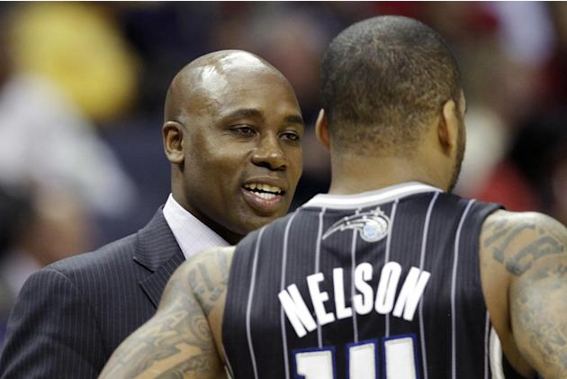 Orlando Magic coach Jacque Vaughn, left, talks to Orlando Magic's Jameer Nelson in the second half of an NBA basketball game in Memphis, Tenn., Monday, Dec. 9, 2013. The Grizzlies defeated the Mag
