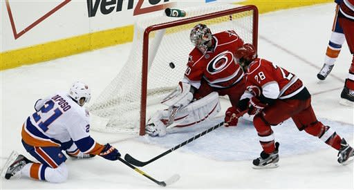 Isles top Canes 4-3 in SO for 3rd straight win