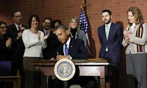 "U.S. President Barack Obama signs the ""omnibus"" spending bill in Washington"