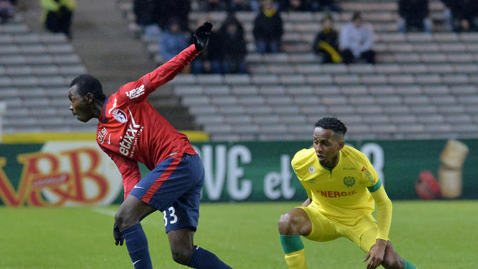 Lille's Adama Traore (L) vies for the ball with Nantes' Chaker Alhadhur during their French L1 football match on January 31, 2015 in Nantes, France