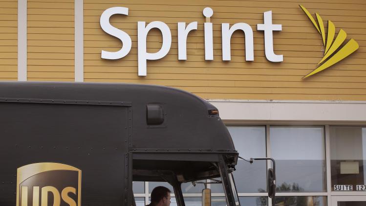 Sprint posts big 4Q loss, revenue rises