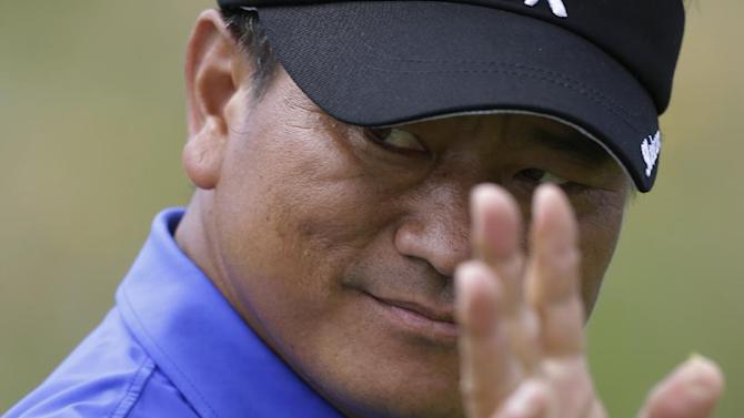 KJ Choi of Korea reacts after putting on the 14th green at Royal Lytham & St Annes golf club during the final round at the British Open Golf Championship, Lytham St Annes, England Sunday, July  22, 2012. (AP Photo/Peter Morrison)