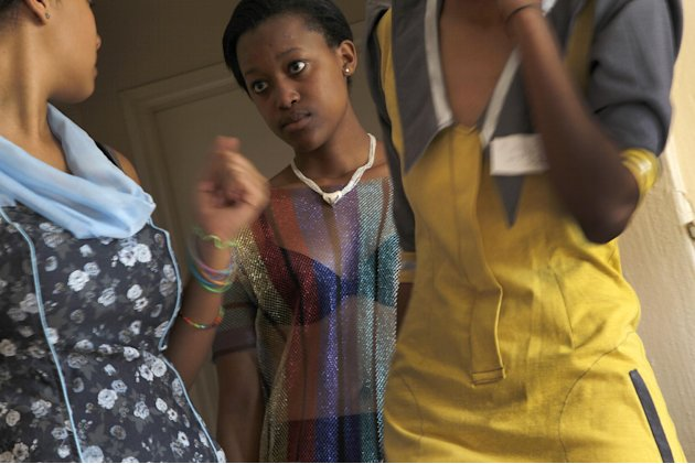 In this photograph shot Saturday May 19, 2012, fashion models rehearse in a Johannesburg, South Africa residential neighborhood  for the Soweto  Fashion Week scheduled to start Thursday May 24, 2012.