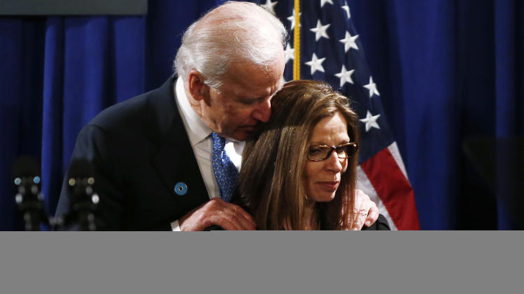 Vice President Joe Biden stands on stage with Janet Blackburn of Ellicott City, Md., who lost her sister, two nephews, and niece to domestic violence, after an event about reducing domestic violence, Wednesday, March 13, 2013, at the Montgomery County Executive Office Building in Rockville, Md.  (AP Photo/Charles Dharapak)