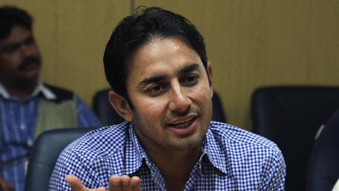 Pakistan's suspended offspinner Saeed Ajmal speaks during a press conference in Lahore, Pakistan, Monday, Sept. 15, 2014. Ajmal said he has overcame disappointment of being suspended from international cricket and hopes to make a strong comeback in next year's World Cup