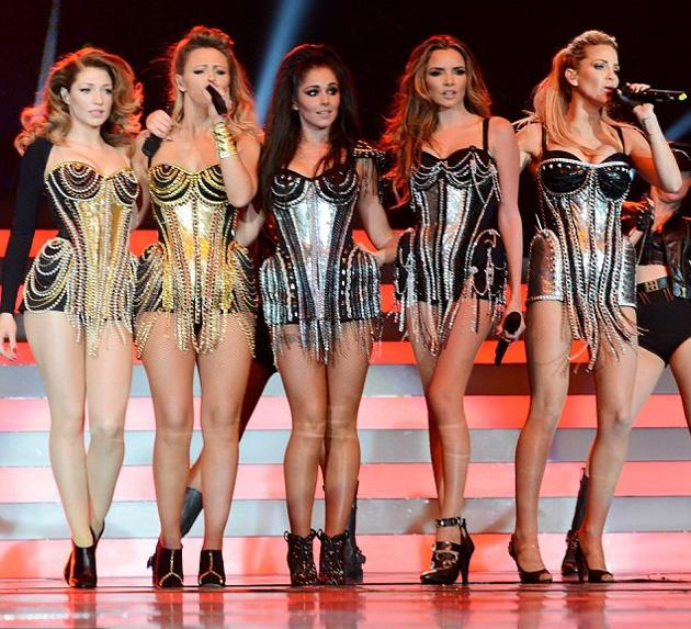 Girls Aloud Ten Tour photos: The girls reunited together back on stage. Copyright [Getty]