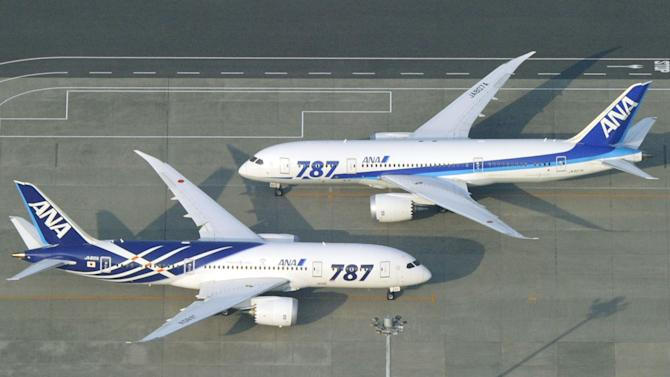 All Nippon Airways Boeing 787 planes sit on a tarmac at Haneda Airport in Tokyo Friday, April 26, 2013. Japan's transport minister said Friday the government is poised to allow Japanese airlines to resume flying grounded Boeing 787s once they complete installation of systems to reduce fire risk in problematic lithium ion batteries. (AP Photo/Kyodo News) JAPAN OUT, MANDATORY CREDIT, NO SALES IN CHINA, HONG KONG, JAPAN, SOUTH KOREA AND FRANCE