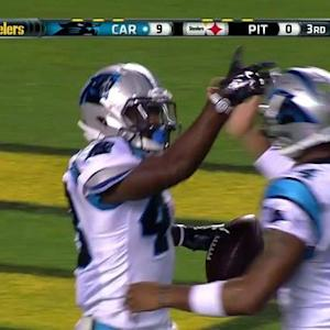 Carolina Panthers running back Fozzy Whittaker rushes for a 2-yard touchdown