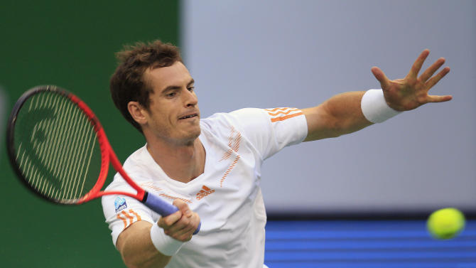Andy Murray of Britain returns a shot against Radek Stepanek of the Czech Republic in their men's singles quarterfinal match at the Shanghai Masters tennis tournament at Qizhong Forest Sports City Tennis Center in Shanghai, China, Friday Oct. 12, 2012. (AP Photo/Eugene Hoshiko)