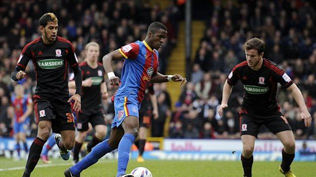 Wilfried Zaha, centre, was instrumental as Crystal Palace cruised to victory
