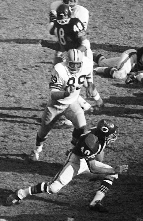 FILE - In this Nov. 27, 1967, file photo, Green Bay Packers Dave Robinson (89) chases Chicago Bears' Gale Sayers (40) during an NFL football game in Chicago. Robinson was selected to the Pro Footb