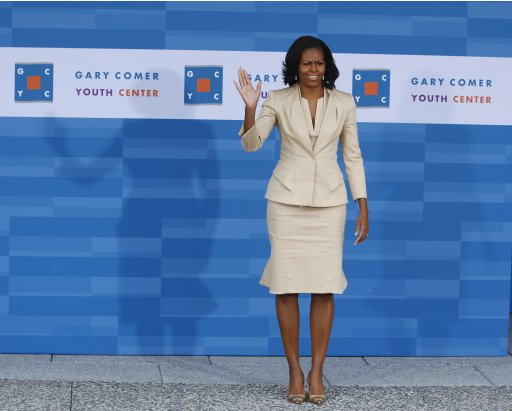 U.S. First Lady Michelle Obama greets the spouses and companions of NATO leaders during a tour of the Gary Comer Youth Center in Chicago