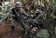 This file photo shows Ecuadorean soldiers patrolling the Ecuador-Colombia border, in 2009. Ecuadoran authorities said on Saturday they had rescued two women tourists, one from Britain and another from Australia, who were kidnapped a day earlier near the Colombian border