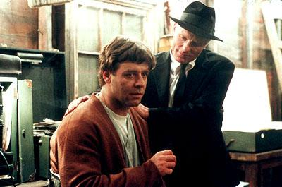 Russell Crowe as John Forbes Nash Jr. and Ed Harris as William Parcher in Universal's A Beautiful Mind