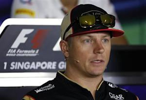 Lotus Formula One driver Kimi Raikkonen of Finland speaks during a news conference ahead of the Singapore F1 Grand Prix
