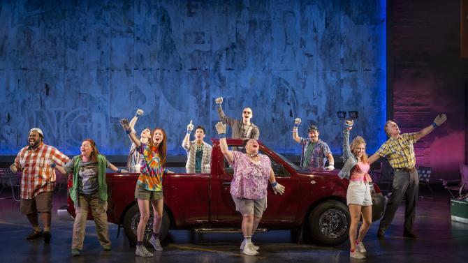"""FILE - This file theater image released by The Hartman Group shows the cast during a performance of """"Hands on a Hard Body,""""  at the Brooks Atkinson Theater in New York and featuring songs co-written by Phish frontman Trey Anastasio.  (AP Photo/The Hartman Group, Chad Batka, File)"""