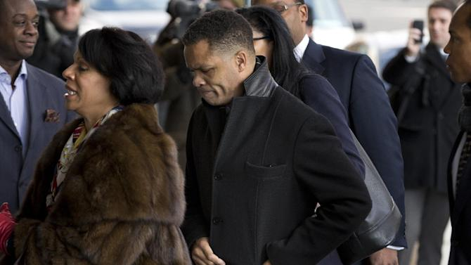 Former Illinois Rep. Jesse Jackson Jr. and his legal team arrives at the E. Barrett Prettyman Federal Courthouse in Washington, Wednesday, Feb. 20, 2013. Jackson and his wife were to appear in federal court to answer criminal charges that they engaged in an alleged scheme to spend $750,000 in campaign funds on personal items. (AP Photo/Evan Vucci)