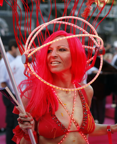 A guest in costume arrives for the opening ceremony of the 20th Life Ball in front of the city hall in Vienna, Austria, on Saturday, May 19, 2012. The Life Ball is a charity gala to raise money for people living with HIV and AIDS. (AP Photo/Ronald Zak)