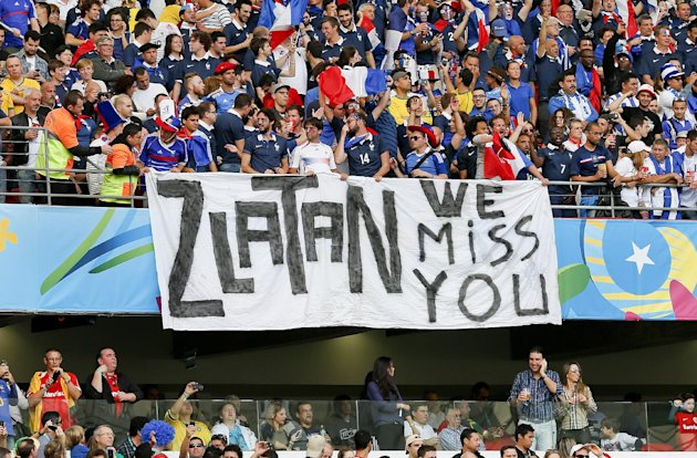 French supporters hold a banner referring to Swedish player Zlatan Ibrahimovic before the group E World Cup soccer match between France and Honduras at the Estadio Beira-Rio in Porto Alegre, Brazil, Sunday, June 15, 2014. Zlatan plays for PSG in the French league and is not in Brazil as Sweden did not qualify. (AP Photo/Jon Super)