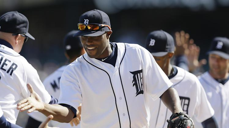 Detroit Tigers right fielder Torii Hunter and teammates celebrate a 5-2 win over the Los Angeles Angels in a baseball game in Detroit, Saturday, April 19, 2014. (AP Photo/Carlos Osorio)