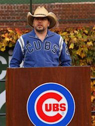 Country singer Jason Aldean speaks during a news conference at Wrigley Field to announce his 2013 Night Train Tour on Thursday, Oct. 18, 2012, in Chicago. (Photo by Barry Brecheisen/Invision/AP)