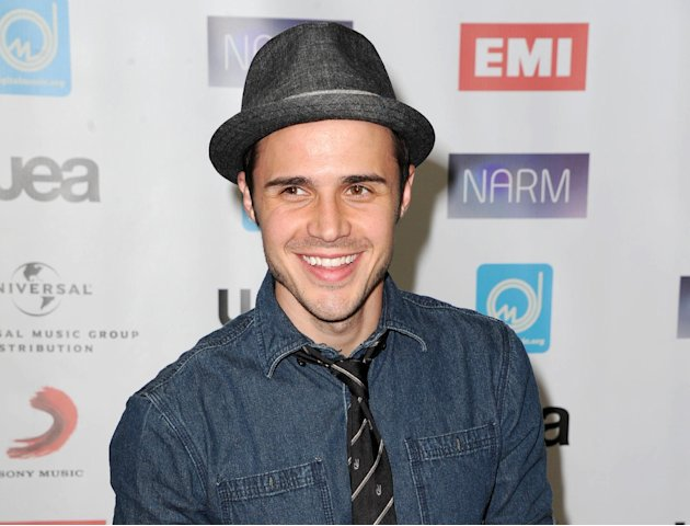 "FILE - This May 10, 2012 file photo shows singer Kris Allen, season eight winner of the singing competition series ""American Idol,"" at NARM Music Biz 2012 Awards in Century City, Calif. Allen's second"