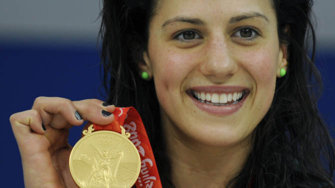 TO GO WITH: Swim-world-AUS-Rice,PROFILE by Robert Smith(FILES) In a file picture taken on August 10, 2008 Australia's Stephanie Rice holds her medal after the women's 400m individual medley swimming final at the National Aquatics Center druing the 2008 Beijing Olympic Games in Beijing. Australia's Stephanie Rice returns to China verging on her best form for the Shanghai world championships, three chequered years after her glittering highs at the Beijing Olympics. AFP PHOTO / TIMOTHY CLARY (Photo credit should read TIMOTHY CLARY/AFP/Getty Images)