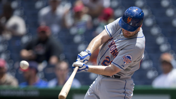 New York Mets' Daniel Murphy hits a solo home run during the first inning of a baseball game against the Washington Nationals at Nationals Park on Friday, July 26, 2013, in Washington. (AP Photo/Evan Vucci)