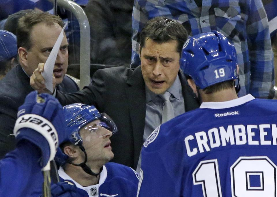 In this Saturday, Feb. 2, 2013 photo, Tampa Bay Lightning head coach Guy Boucher talks to his team during the second period of an NHL hockey game against the New York Rangers, in Tampa, Fla. The Tampa Bay Lightning fired Boucher on Sunday, March 24, 2013. (AP Photo/Chris O'Meara)