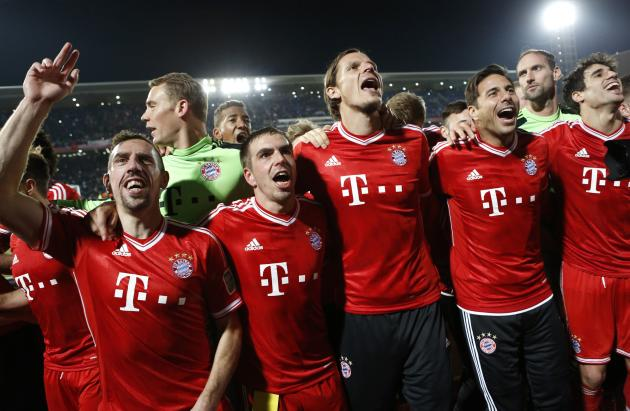 Germany's Bayern Munich players celebrate after winning their 2013 FIFA Club World Cup final soccer match against Morocco's Raja Casablanca at Marrakech stadium