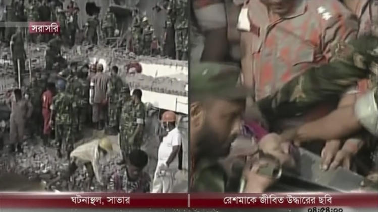 In this image taken from a TV footage released by AP video, rescuers carry a woman survivor out of a collapsed building in a right screen in Savar near Dhaka, Bangladesh, Friday, May 10, 2013. Rescue workers in Bangladesh freed a woman buried for 17 days inside a prayer room in the wreckage of a collapsed garment factory building. The amazing rescue took place Friday as the death toll from the disaster raced past 1,000, making it one of the worst industrial tragedies in history. (AP Photo/Somoy TV via AP Video) BANGLADESH OUT