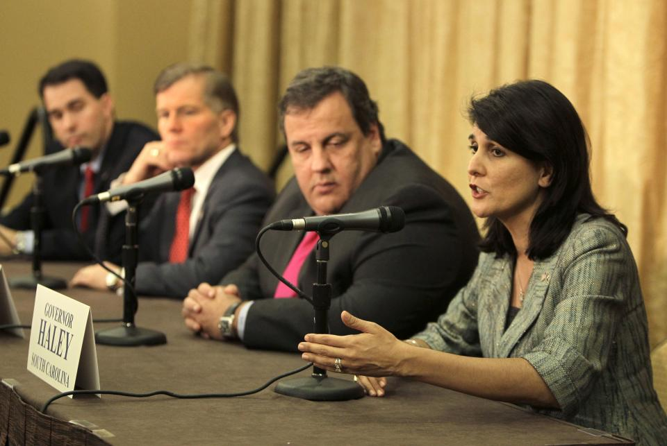South Carolina Gov. Nikki Haley, far right, makes comments at a news conference as fellow governors, from left, Wisconsin Gov. Scott Walker, Virginia Gov. Bob McDonnell and New Jersey Gov. Chris Christie, listen during  the Republican Governors Association annual conference in Orlando, Fla., Wednesday, Nov. 30, 2011. (AP Photo/John Raoux)