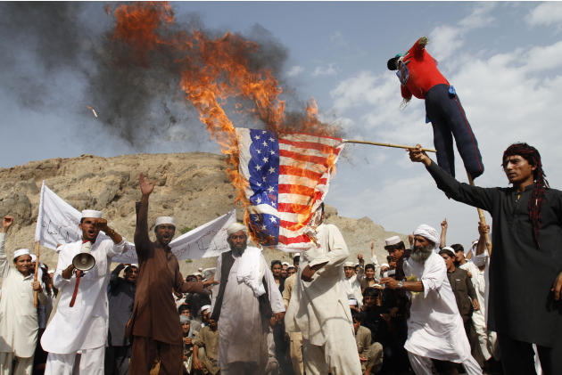 Afghans burn the U.S. flag in Ghanikhel district of Nangarhar province, east of Kabul, Afghanistan, Friday, Sept. 14, 2012 during a protest against an anti-Islam film which depicts the Prophet Muhamma