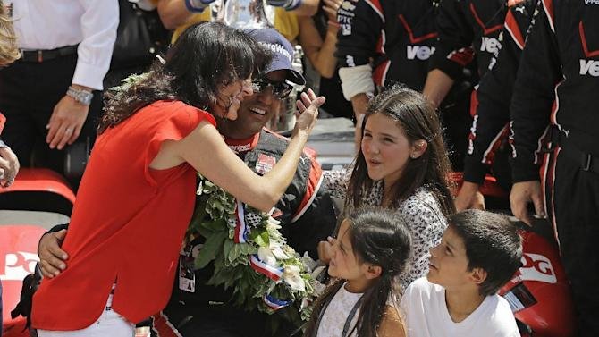 Juan Pablo Montoya, of Colombia, celebrates with his family after winning the 99th running of the Indianapolis 500 auto race at Indianapolis Motor Speedway in Indianapolis, Sunday, May 24, 2015. (AP Photo/Darron Cummings)