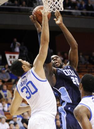 Old Dominion's Chris Cooper, right, shoots over Kentucky's Eloy Vargas during the first half of their NCAA college basketball game at the Hall of Fame Tip-Off tournament in Uncasville, Conn., on Sunday, Nov. 20, 2011. (AP Photo/Fred Beckham)