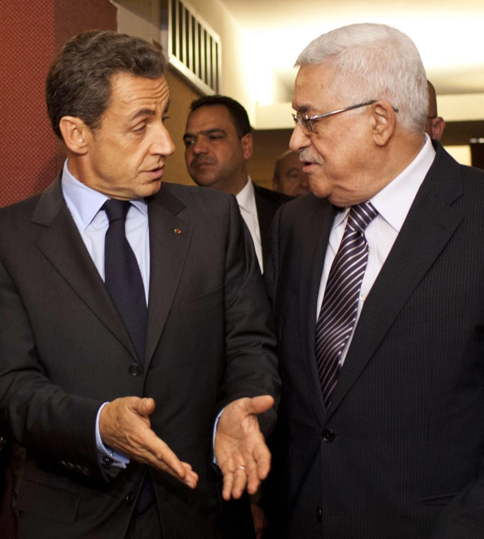 French President Nicolas Sarkozy, left, meets with Palestinian President Mahmoud Abbas at the Millennium Hotel in New York during the 66th session of the United Nations General Assembly on Tuesday, Sept. 20, 2011. (AP Photo/Andrew Burton)