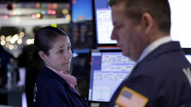 Traders work on the floor at the New York Stock Exchange in New York, Thursday, Dec. 18, 2014.   The market is opening sharply higher, building on gains from the day before after the Federal Reserve indicated it was in no rush to raise interest rates. (AP Photo/Seth Wenig)